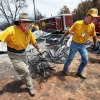 Jim Cook, left, of Choctaw, and Paul Hickerson, of Mountain Park, remove debris Tuesday as volunteers with the Baptist General Convention of Oklahoma's disaster relief team clean up a property in Norman after last week's wildfires. Photo by Steve Sisney, The Oklahoman