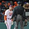 Clemson head coach Jack leggett, left, questions home plate umpire Jack Cox about a call in the fifth inning in an NCAA college baseball game on Friday, March 1, 2013, in Clemson, S.C. (AP Photo/Anderson Independent-Mail, Mark Crammer) GREENVILLE NEWS OUT, SENECA NEWS OUT