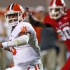 Clemson\'s Tajh Boyd, left, looks to pass the ball during the first half of an NCAA college football game against North Carolina State in Raleigh, N.C., Thursday, Sept. 19, 2013. (AP Photo/Karl B DeBlaker)