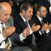 FILE - In this Sunday, Aug. 19, 2012 file photo released by the Egyptian Presidency, Egyptian Vice President, Mahmoud Mekki, left, President Mohammed Morsi, second left, Prime Minister Hesham Kandil, third left, and the Grand Sheik of Al-Azhar, Ahmed el-Tayeb, right, attend Eid el Fitr prayers in Amr Ibn Al-As mosque to mark the start of a three-day Muslim holiday that marks the end of the Muslim holy month of Ramadan. Egypt\'s state TV says Vice President Mahmoud Mekki has resigned. Mekki\'s Saturday, Dec. 22, 2012 resignation was announced with more than five hours to go of voting in the second and final phase of a referendum on a disputed, Islamist-backed constitution. (AP Photo/Egyptian Presidency, File)