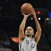 Photo - San Antonio Spurs guard Tony Parker, of France, shoots during the first half of an NBA basketball game against the Phoenix Suns on Friday, April 11, 2014, in San Antonio. (AP Photo/Darren Abate)