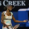 Venus Williams of the US reacts during her third round loss to Russia\'s Maria Sharapova at the Australian Open tennis championship in Melbourne, Australia, Friday, Jan. 18, 2013. (AP Photo/Dita Alangkara)