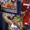 Oklahoma City\'s Thabo Sefolosha (2) dunks over over Miami\'s Mario Chalmers (15) during Game 1 of the NBA Finals between the Oklahoma City Thunder and the Miami Heat at Chesapeake Energy Arena in Oklahoma City, Tuesday, June 12, 2012. Photo by Sarah Phipps, The Oklahoman