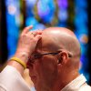 Deacon Marilyn Robertson traces a cross in ashes on a man\'s forehead during Ash Wednesday service at St. Paul\'s Episcopal Cathedral in downtown Oklahoma City on Wednesday, Feb 22, 2012. Photo by Jim Beckel, The Oklahoman