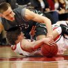 Photo - Edmond Santa Fe's Curran Scott (23), top, and Yukon's Tanner Akers (5) chase a loose ball during a boys high school basketball game between Edmond Santa Fe and Yukon at Yukon High School in Yukon, Okla., Friday, Jan. 31, 2014. Photo by Nate Billings, The Oklahoman