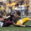 Photo - Wyoming quarterback Colby Kirkegaard fails to get a pass off as he is brought down by Montana's Tyrone Holmes during the Cowboys' season opener NCAA football game against Montana on Saturday, Aug. 30, 2014, at War Memorial Stadium in Laramie, Wyo. (AP Photo/Casper Star-Tribune, Ryan Dorgan)