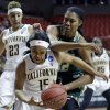 California guard Brittany Boyd (15) and South Florida center Akila McDonald (32) battle for the ball during the first half of a second-round game in the women\'s NCAA college basketball tournament in Lubbock, Texas, Monday, March 25, 2013. California guard Layshia Clarendon (23) watches. (AP Photo/LM Otero)