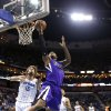 Sacramento Kings center DeMarcus Cousins (15) drives to the basket past New Orleans Hornets center Robin Lopez (15) in the first half of an NBA basketball game in New Orleans, Sunday, Feb. 24, 2013. (AP Photo/Gerald Herbert)
