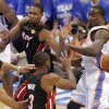 Miami\'s Chris Bosh (1) passes the ball in front of Oklahoma City\'s Kendrick Perkins (5) during Game 2 of the NBA Finals between the Oklahoma City Thunder and the Miami Heat at Chesapeake Energy Arena in Oklahoma City, Thursday, June 14, 2012. Photo by Chris Landsberger, The Oklahoman