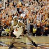 Photo - OSU / CELEBRATION: JamesOn Curry celebrates at halfcourt in the second overtime of Oklahoma State's 93-91 win during the men's college basketball game between Oklahoma State University Cowboys and Texas Tech University Red Raiders at Gallagher-Iba Arena in Stillwater, Okla., Saturday, Feb. 10, 2007. By Matt Strasen, The Oklahoman ORG XMIT: KOD