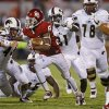 Oklahoma\'s Jalen Saunders (8) fights of Louisiana Monroe\'s Madison Tharp (46) on a long punt return during a college football game between the University of Oklahoma Sooners (OU) and the University of Louisiana Monroe Warhawks at Gaylord Family-Oklahoma Memorial Stadium in Norman, Okla., on Saturday, Aug. 31, 2013. Oklahoma won 34-0. Photo by Bryan Terry The Oklahoman