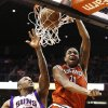 Milwaukee Bucks\' John Henson (31) dunks as Phoenix Suns\' P.J. Tucker (17) tries to defend in the first half during an NBA basketball game on Thursday, Jan. 17, 2013, in Phoenix. (AP Photo/Ross D. Franklin)