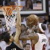 The Miami Heat\'s LeBron James (6) shoots against the San Antonio Spurs\' Danny Green (4) during the first half in Game 7 of the NBA basketball championships, Thursday, June 20, 2013, in Miami. (AP Photo/Lynne Sladky)