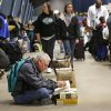 Drew Mehner of Edmond sits with his stash of books while waiting for his wife to finish her shopping. Mehner said he and his wife have been coming to the book sale for several years. Several thousand bibliophiles and bargain hunters crowded into Oklahoma Expo Hall at State Fair Park on Saturday, Feb. 23, 2013, in a quest to find reading material at deeply discounted prices. Friends of the Metropolitan Library System is holding their much-anticipated annual book sale this weekend. The sale continues Sunday from 9 a.m. to 5:30 p.m. Photo by Jim Beckel, The Oklahoman