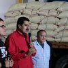 In this photo provided by Miraflores Presidential Press Office, Venezuela\'s Vice President Nicolas Maduro, center, delivers a speech during a visit to