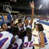 The Millwood team, including Derae Lewis, arm raised, celebrates following their 64-50 win over Prague in the Class 3A girls high school state basketball championship game at State Fair Arena in Oklahoma City, Saturday, March 10, 2012. Photo by Bryan Terry, The Oklahoman