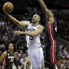 San Antonio Spurs\' Tony Parker (9) shoots around Miami Heat\'s Udonis Haslem during the first half at Game 4 of the NBA Finals basketball series, Thursday, June 13, 2013, in San Antonio. (AP Photo/Eric Gay)