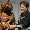 Photo - Brazil's President Dilma Rousseff, right, embraces Nnenna Nwakanma, a free Internet activist from Nigeria, at the opening ceremony of NETmundial, a major conference on the future of Internet governance in Sao Paulo, Brazil, Wednesday, April 23, 2014. Brazil has cast itself as a defender of Internet freedom following revelations last year that Rousseff was the object of surveillance by the United States' National Security Agency.  (AP Photo/Andre Penner)