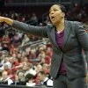Photo - Temple head coach Tonya Cardoza shouts instructions to her team during the first half of an NCAA college basketball game against Louisville, Wednesday, Feb. 12, 2014, in Louisville, Ky. (AP Photo/Timothy D. Easley)