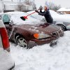 Snowfall came to an end Friday night and many Oklahomans spent time Saturday, Jan. 30, 2010, clearing snow and ice from their vehicles, driveways and sidewalks. A woman who only would give her name as Florence uses a broom to clear snow from her car in the parking lot of her Del City apartment on Tyanne Blvd. Photo by Jim Beckel, The Oklahoman