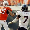 OSU\'s Seth Newton (15) throws a touchdown pass on a trick play as Texas Tech\'s Darcel McBath (10) defends in the fourth quarter of the college football game between the Oklahoma State University Cowboys (OSU) and the Texas Tech University Red Raiders (TTU) at Boone Pickens Stadium in Stillwater, Okla., on Saturday, Sept. 22, 2007. OSU won, 49-45. By NATE BILLINGS, The Oklahoman