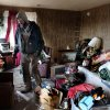 CORRECTS DAY OF STORM OUTBREAK TO FRIDAY - Matthew Bailey of Milan, Ind., tries to salvage belongings from his wife\'s grandmother\'s home in Holton, Ind. on Sunday March 4, 2012. A string of violent storms scratched away small towns in Indiana and cut off rural communities in Kentucky as an early-season tornado outbreak struck on Friday, killing at least 37 people. (AP Photo/Ernest Coleman) ORG XMIT: INEC101