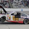 Photo - Dale Earnhardt Jr.'s (88) car is towed off the track after a wreck during the NASCAR Sprint Cup series auto race at Texas Motor Speedway, Monday, April 7, 2014, in Fort Worth, Texas. (AP Photo/Larry Papke)