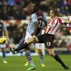 Photo - Sunderland's captain Lee Cattermole, right, vies for the ball with Aston Villa's Christian Benteke during their English Premier League soccer match at the Stadium of Light, Sunderland, England, Wednesday, Jan. 1, 2014. (AP Photo/Scott Heppell)