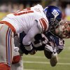 New York Giants cornerback Aaron Ross (31) stops New England Patriots wide receiver Wes Welker (83) during the first half of the NFL Super Bowl XLVI football game, Sunday, Feb. 5, 2012, in Indianapolis. (AP Photo/Mark Humphrey) ORG XMIT: SB246