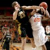 Missouri\'s Justin Saford defends OSU\'s Obi Byron Eaton during the Big 12 college basketball game between Oklahoma State and Missouri at Gallagher-Iba Arena in Stillwater, Okla., Wednesday, Jan. 21, 2009. PHOTO BY BRYAN TERRY, THE OKLAHOMAN