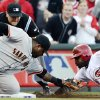 San Francisco Giants third baseman Pablo Sandoval tags out Cincinnati Reds\' Brandon Phillips at third base in the first inning during Game 3 of the National League division baseball series, Tuesday, Oct. 9, 2012, in Cincinnati. (AP Photo/Michael Keating)
