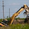 A backhoe cleans out an old pond at the Cushing Superfund sight. Clean up is taking place at the Cushing, Okla Superfund site on Tuesday June 22, 2009. Photo by Mitchell Alcala, The Oklahoman ORG XMIT: KOD