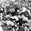 UNIVERSITY OF OKLAHOMA: OU running back Billy Sims plows through some would-be Missouri tacklers during the OU-Missouri game in Norman in September of 1978. Staff photo by Bob Albright taken 9/30/78; photo ran in the 3/23/80 Daily Oklahoman. File: College Football/OU/OU-Missouri/Billy Sims/1978