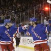 Photo - New York Rangers' Benoit Pouliot, right, celebrates with teammate Derick Brassard after scoring a goal during the second period of an NHL hockey game against the Carolina Hurricanes on Tuesday, April 8, 2014, in New York. (AP Photo/Frank Franklin II)