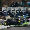 Police officers rest next to Ukraine\'s parliament in Kiev, Ukraine, Thursday, Feb. 20, 2014. Ferocious street battles between protesters and police in the Ukrainian capital have left dozens dead and hundreds wounded in the past few days, raising fears that the ex-Soviet nation, whose loyalties are split between Russia and the West, is in an uncontrollable spiral of violence. (AP Photo/Petro Zadorozhnyy)