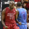Miami Heat\'s Joel Anthony (50) reacts after scoring against the Oklahoma City Thunder during the second half of an NBA basketball game in Miami, Tuesday, Dec. 25, 2012. The Heat won 103-97. (AP Photo/J Pat Carter) ORG XMIT: FLJC120