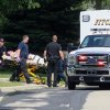 Photo - FILE - In this Aug. 22, 2014 file photo emergency personnel transport Andy Steele from his home in Fitchburg, Wis., where authorities said Steele's wife, Ashlee Steele and sister-in-law, Kacee Tollesfsbol, were found shot dead. Authorities said Tuesday, Aug. 26, 2014 that Tollefsbol called 911 around 1 p.m. Friday and said Andy Steele had shot her in the back. Andy Steele was arrested but hasn't been charged. (AP Photo/Wisconsin State Journal, John Hart, File)