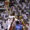 Miami\'s Dwyane Wade (3) goes past Oklahoma City\'s Russell Westbrook (0) and Kendrick Perkins (5) during Game 4 of the NBA Finals between the Oklahoma City Thunder and the Miami Heat at American Airlines Arena, Tuesday, June 19, 2012. Photo by Bryan Terry, The Oklahoman