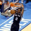 San Antonio\'s Kawhi Leonard (2) dunks during Game 6 of the Western Conference Finals in the NBA playoffs between the Oklahoma City Thunder and the San Antonio Spurs at Chesapeake Energy Arena in Oklahoma City, Saturday, May 31, 2014. Photo by Nate Billings, The Oklahoman