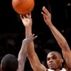 Oklahoma City\'s Russell Westbrook puts up a shot in front of Philadelphia\'s Jrue Holiday during the second half of their NBA basketball game at the Ford Center in Oklahoma City on Tuesday, Dec. 2, 2009. The Thunder beat the 76ers 117 to 106. By John Clanton, The Oklahoman