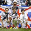 Los Angeles Galaxy\'s David Beckham, top center, of England, poses with his sons, from left, Brooklyn, Romeo and Cruz after the Galaxy\'s 3-1 win in the MLS Cup championship soccer match against the Houston Dynamo in Carson, Calif., Saturday, Dec. 1, 2012. (AP Photo/Jae C. Hong)