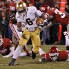 Notre Dame \'s Theo Riddick (6) cuts through the Sooner defense to score a touchdown to put the Irish up 30-13 during the college football game between the University of Oklahoma Sooners (OU) and the Notre Dame Fighting Irish at the Gaylord Family-Oklahoma Memorial Stadium on Saturday, Oct. 27, 2012, in Norman, Okla. Photo by Chris Landsberger, The Oklahoman