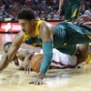 Photo - Baylor guard Ish Wainright, top, dives over Oklahoma guard Jordan Woodard for a loose ball in the first half of an NCAA college basketball game in Norman, Okla., Saturday, Feb. 8, 2014. (AP Photo/Sue Ogrocki)