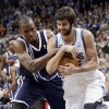 Photo - Oklahoma City Thunder's Serge Ibaka, left, of Congo, and Minnesota Timberwolves' Ricky Rubio vie for a loose ball in the second half of an NBA basketball game Saturday, Jan. 4, 2014, in Minneapolis. A jump ball was called on the play. The Thunder won 115-111. (AP Photo/Jim Mone)