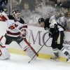 New Jersey Devils goalie Martin Brodeur, left, plays the puck past Pittsburgh Penguins\' Joe Vitale (46) during the first period of an NHL hockey game, Saturday, Feb. 2, 2013, in Pittsburgh. (AP Photo/Keith Srakocic)