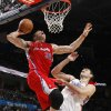 Los Angeles\' Blake Griffin (32) goes to the basket beside Oklahoma City\'s Nenad Krstic (12) during the NBA basketball game between the Oklahoma City Thunder and the Los Angeles Clippers at the Oklahoma CIty Arena, Tuesday, Feb. 22, 2011. Photo by Bryan Terry, The Oklahoman