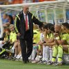 Photo - Spain's head coach Vicente Del Bosque greets his bench players during the group B World Cup soccer match between Spain and the Netherlands at the Arena Ponte Nova in Salvador, Brazil, Friday, June 13, 2014.The Netherlands won the match 5-1. (AP Photo/Manu Fernandez)