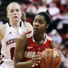 Ohio State\'s Tayler Hill drives past Nebraska\'s Lindsey Moore, rear, in the second half of their NCAA college basketball game in Lincoln, Neb., Sunday, Feb. 26, 2012. Nebraska won 71-57. (AP Photo/Nati Harnik)