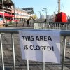 In this Friday, Nov. 23, 2012 photo, barricades close off a section of New York\'s South Street Seaport. The South Street Seaport, a popular tourist destination, remains a ghost town since Superstorm Sandy. (AP Photo/Tina Fineberg)