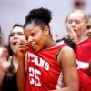 Carl Albert Lady Titans\' Gioya Carter wipes sweat from her face as her teammates and coaches cheer when her name was announced as the tournament MVP following their team\'s 47-35 win over the Millwood Lady Falcons in the 2012 Titan Classic Basketball Tournament at Carl Albert High School, Saturday, Jan. 21, 2012. Photo by Jim Beckel, The Oklahoman